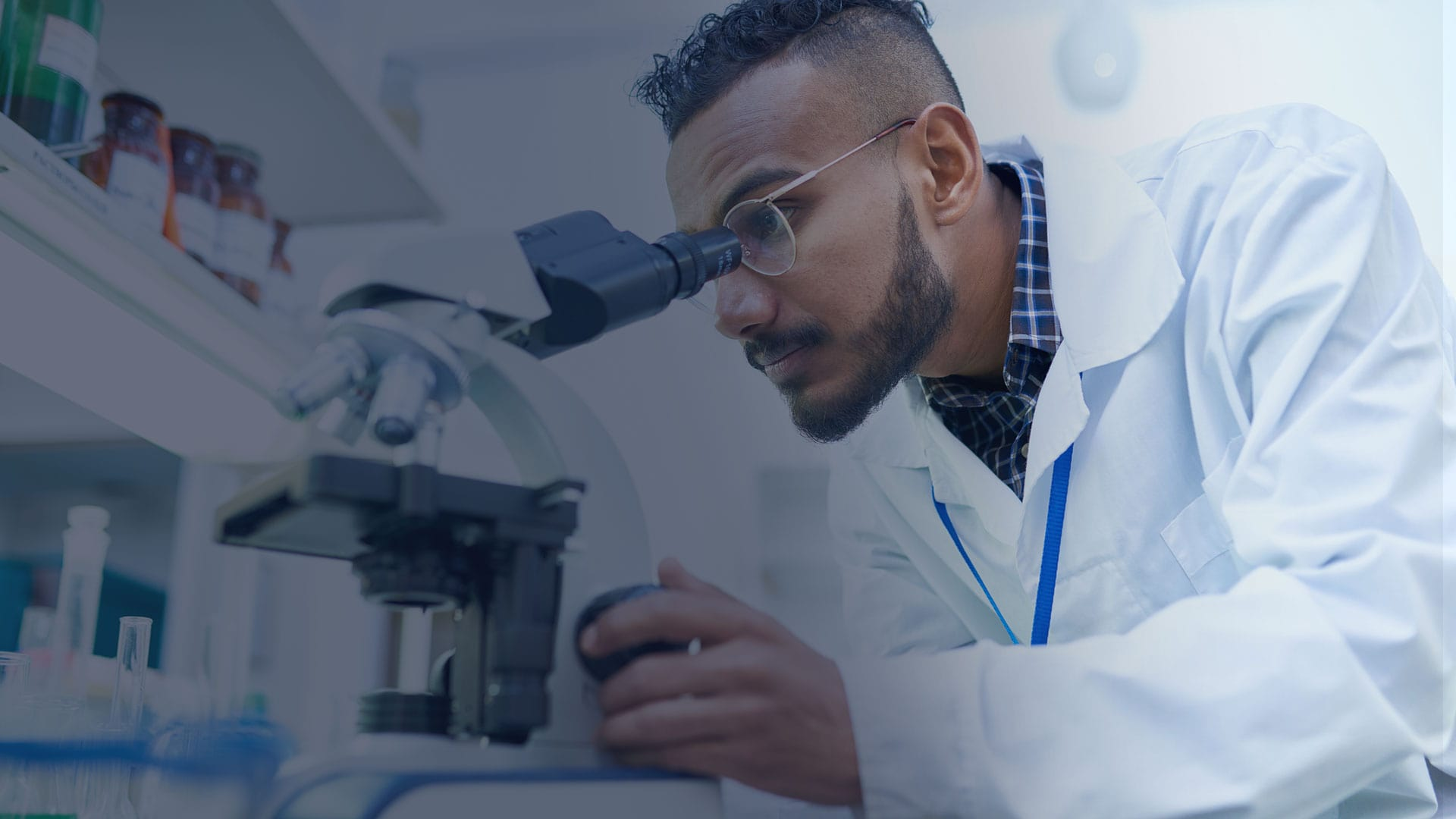 Scientist looking into a microscope - OnKure Therapeutics